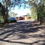 Walking down the road from the mud brick building (238322)