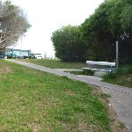 Foot path and metal seat near the Owens Walkway Car Park in Redhead (390800)