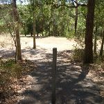Metal post in footpath with a large grassy clearing in Richley Reserve (401941)